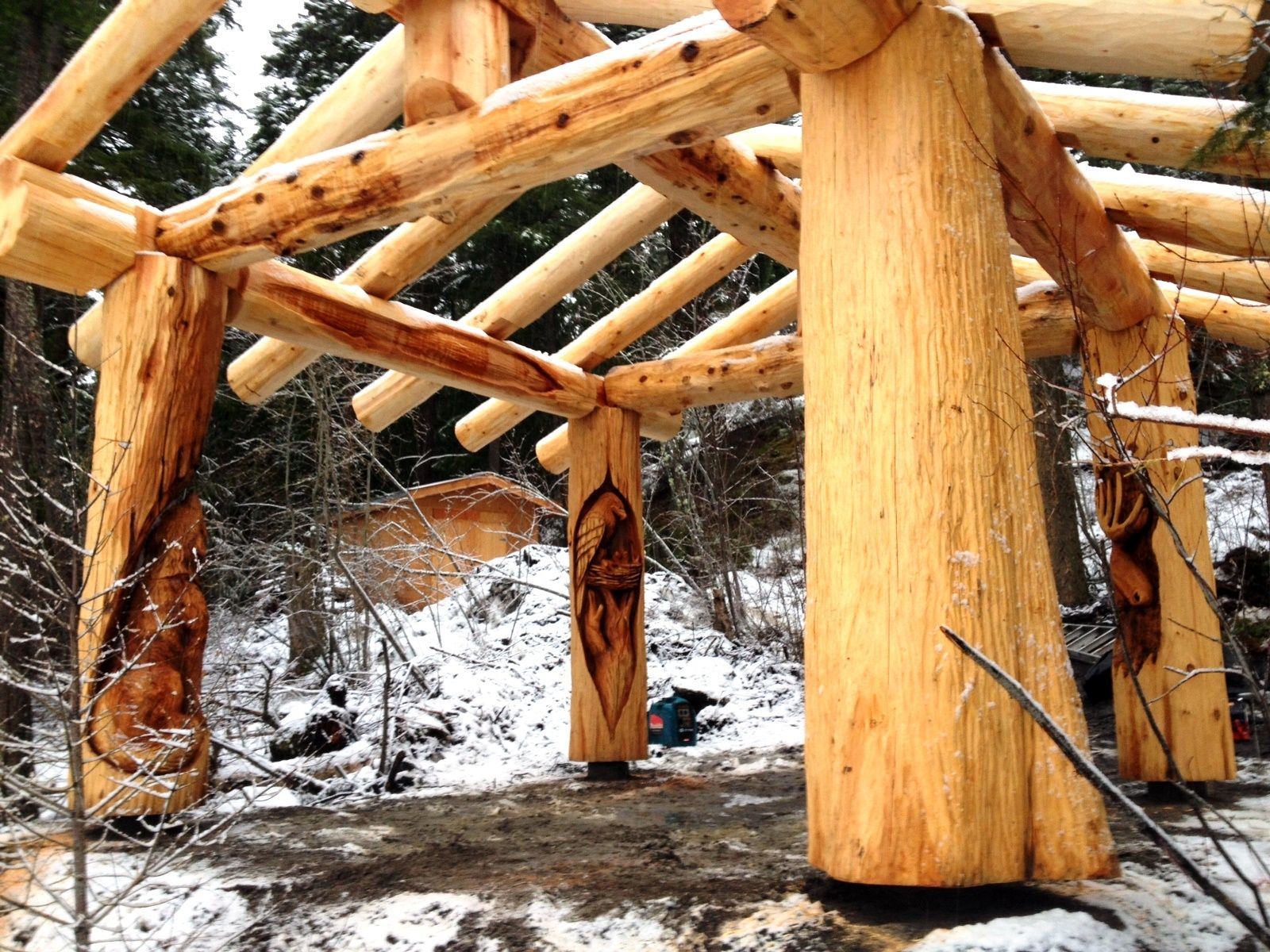 Custom carved gazebo from pioneer log homes of bc wood