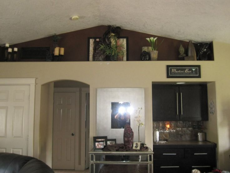 Accent Color On A High Ledge Shelf Decor Living Room Vaulted Ceiling Living Room Home Ceiling