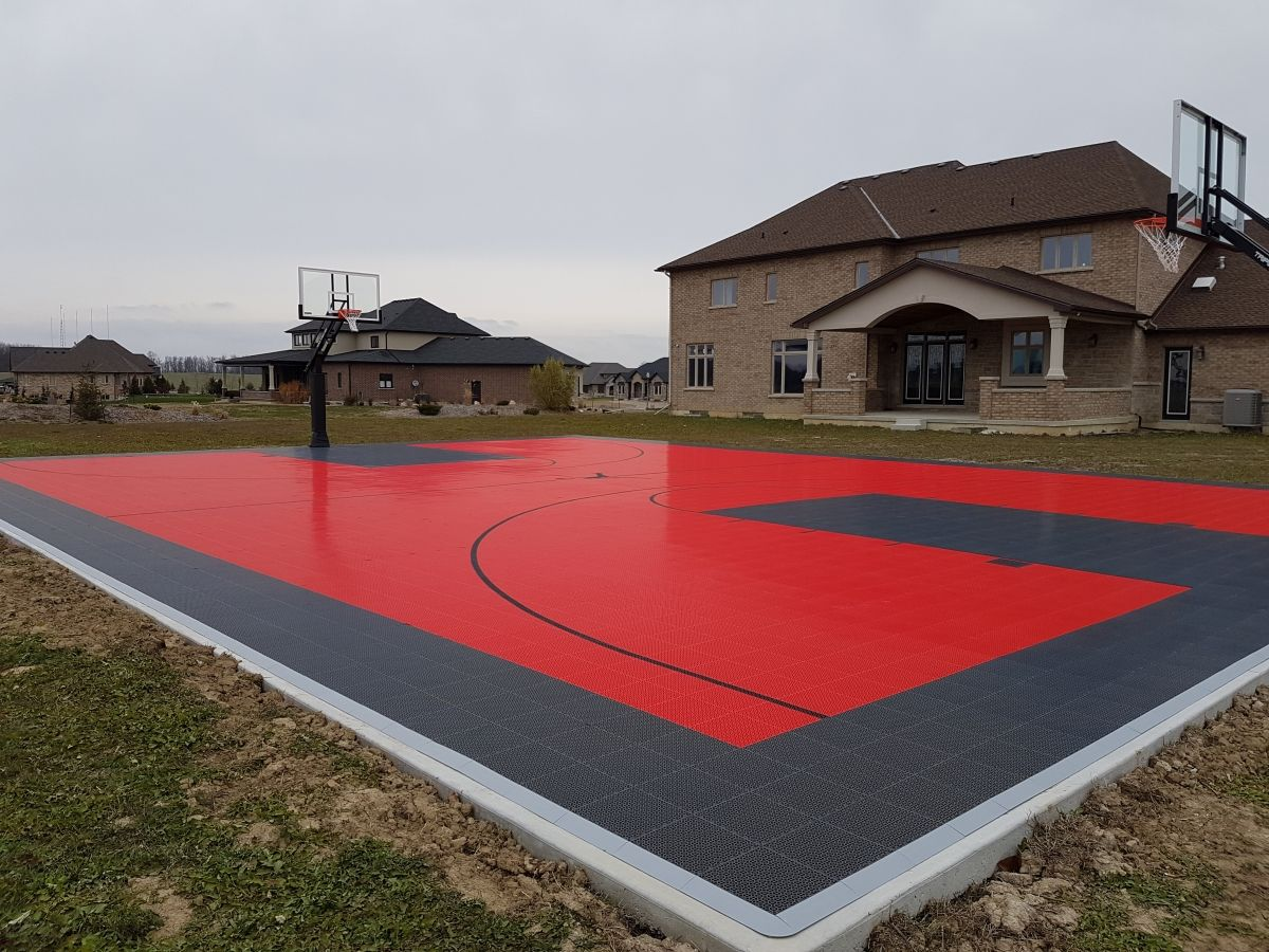Awesome 50 X 64 Backyard Court Near Hamilton On Surface Is The Snapsports Bouncebac Outdoor Basketball Court Home Basketball Court Basketball Court Backyard