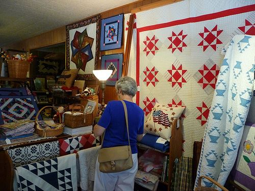 Mom looking at Quilts | Shipshewana indiana, Shopping and Antique ... : shipshewana quilt shops - Adamdwight.com