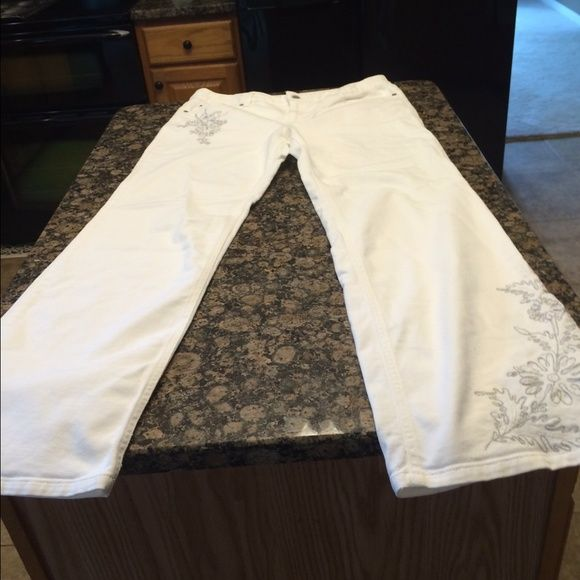 Ann Taylor Loft jeans. White Ann Taylor Loft white jeans with white and silver design on left leg and right pocket. Inseam 29 inches. LOFT Jeans