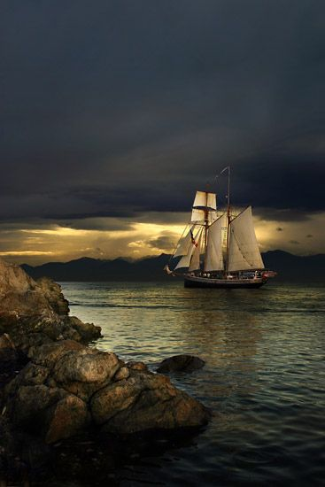 A New Zealand tall ship leaves Victoria Harbour off Vancouver Island heading into the sunset ~ photo by Jason van der Valk