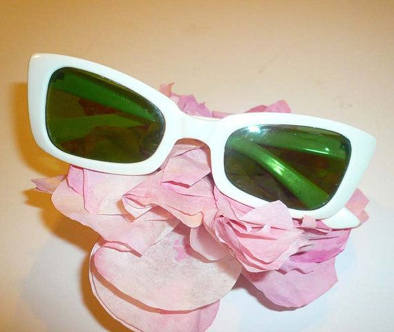 9d0829378 Here are a original pair of vintage 1960's women's white sunglasses with  green plastic lenses. Cool-Ray Polaroid 105 is stamped on the right ear  piece.