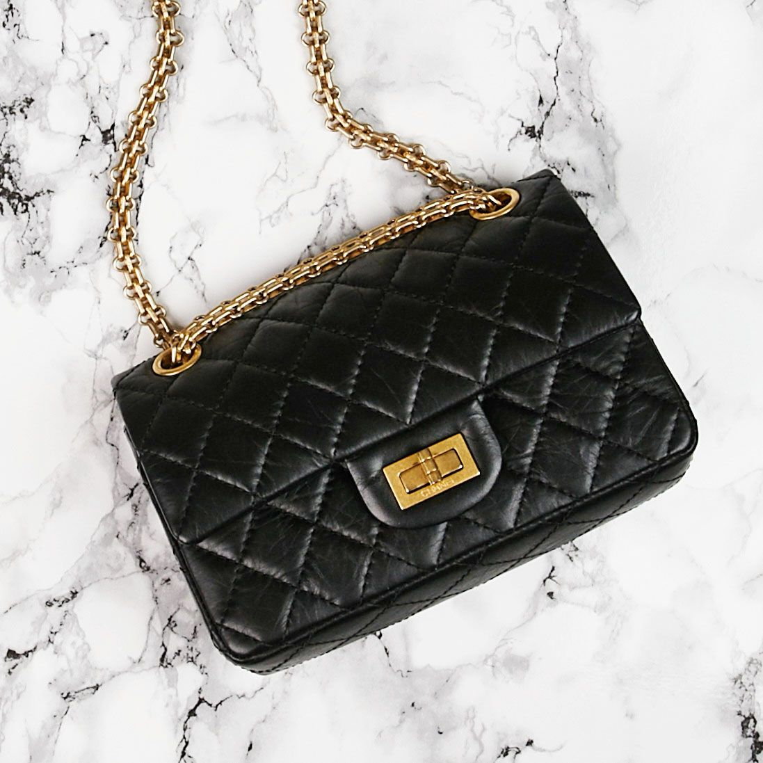 6354ebeafcf9 Add a touch of class to any outfit with this small Chanel 2.55 Reissue  Flap! - Yoogi's Closet | #Chanel