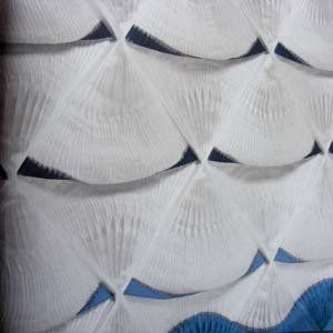 Close-up detail of pleated fan shaped fabric panels... Each section looks quite big so the pleating must all be done by hand - no regularity of smockers here! They also seem to billow out a little at the bottom of the white section adding a three dimensional aspect of movement to the piece.
