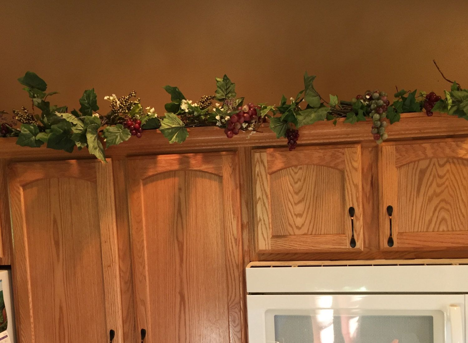 This 6ft Swag Is Filled With Premium Silk Greenery Ivy Berries Grapes And Vines It Has Small Cr Kitchen Cabinets Decor Top Of Cabinets Top Kitchen Cabinets