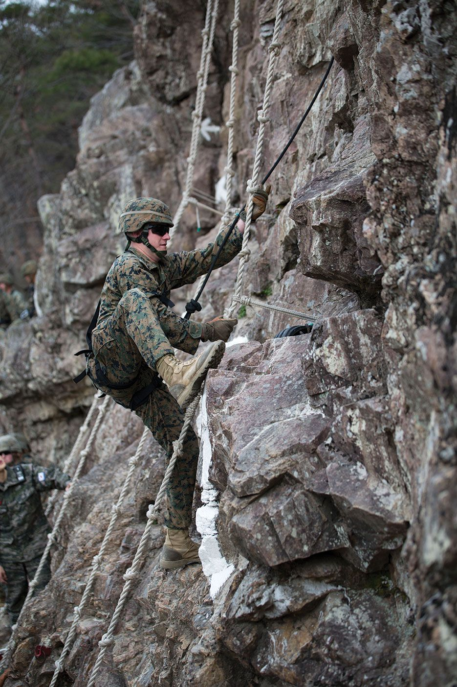 U S Marine Corps Field Radio Operator Climbs Mountainside During Mountain Warfare Training Course As Part Of Marine Expeditionary Force Exercise Mefex 2014