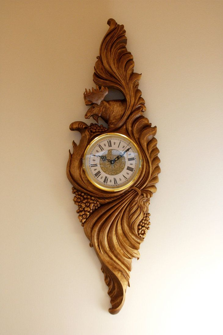 A clock carved in birch cm carving and