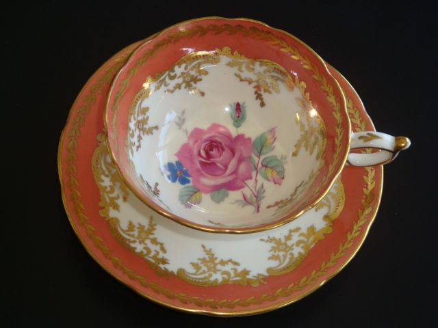 DW Paragon Rose Gold and Pumpkin Tea Cup and Saucer from janshelley on Ruby Lane
