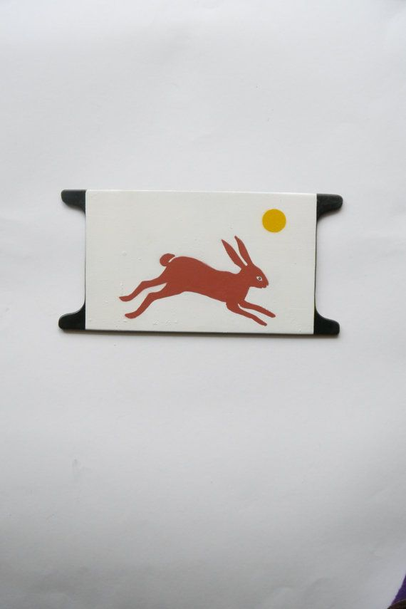 Hand painted old wooden board with rabbit. It reminds to naive art but is a very modern hanging wall sculpture and unique wall decor for your home.
