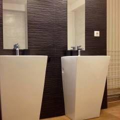 Appartement à Paris  : Salle de bain de style de style Moderne par WM