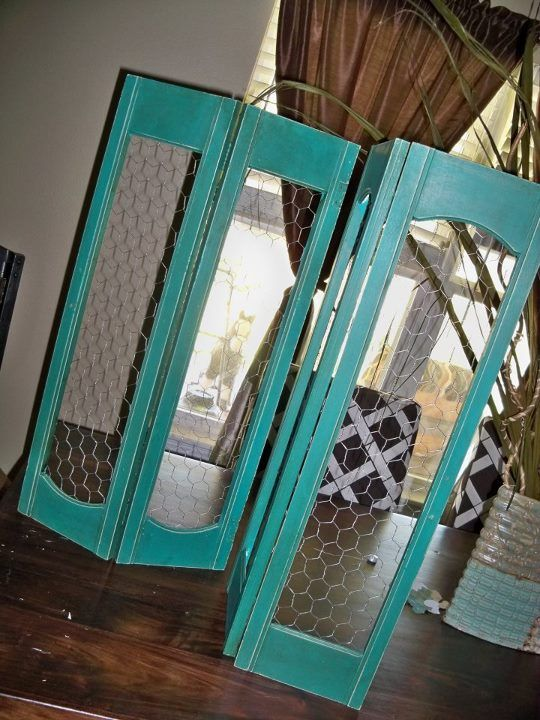 Old shutters painted this popular color with chicken wire !  Room divider!