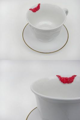 Love it!  Embroidered tea cup.
