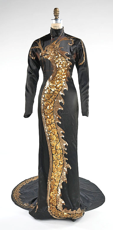 Travis Banton Gown worn by Anna May Wong in Limehouse Blues (1934), via @~ Mlle.. via pinterest 30s black gold sequin beaded dragon dress silk cheongsam qipao chinese dress ethnic Asian vintage fashion