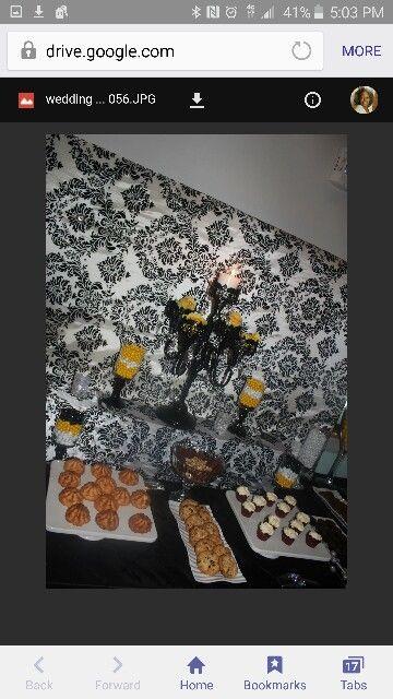Yellow and black wedding sweet table