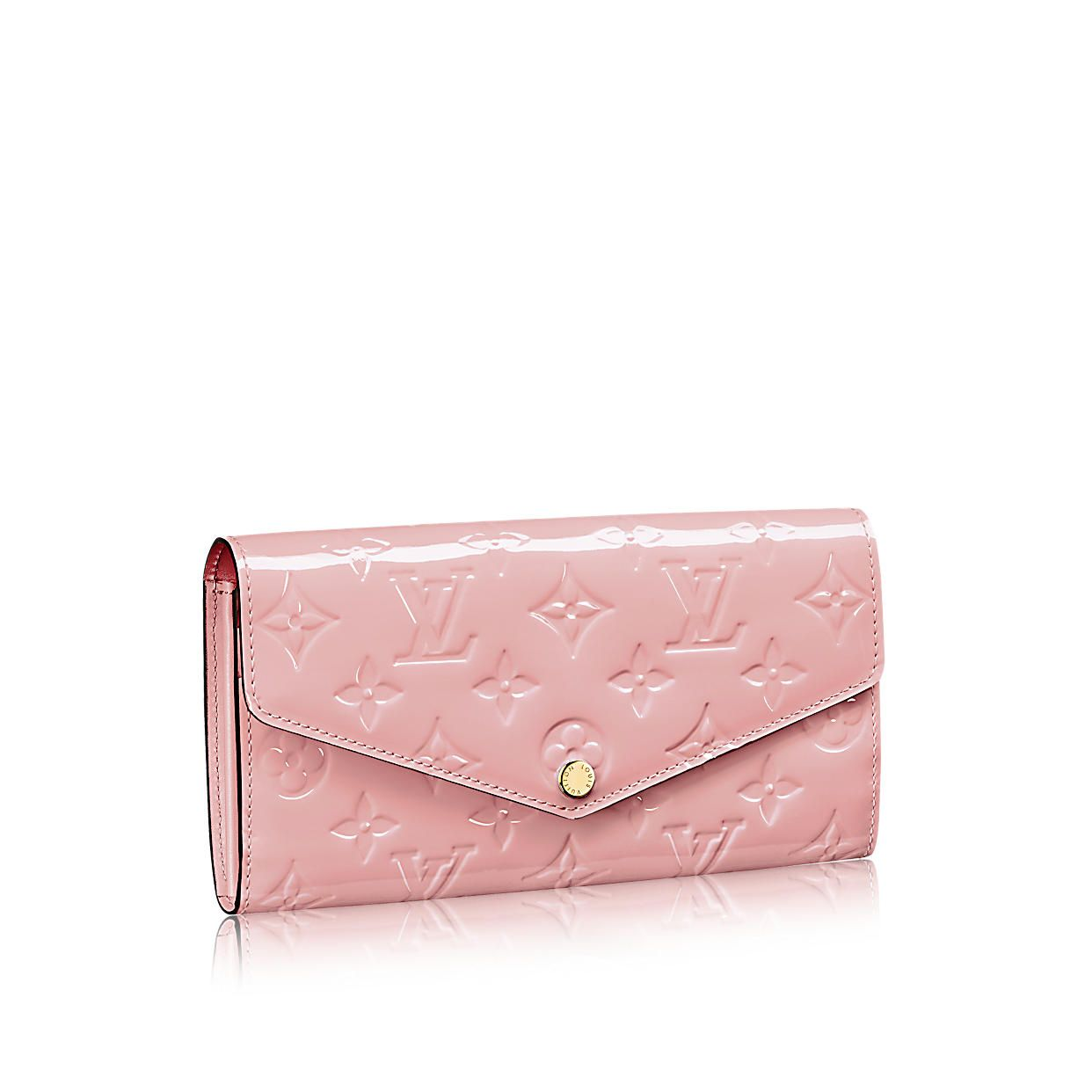 ad9155d0c3a Discover Louis Vuitton Sarah Wallet  This envelope-style Sarah wallet  combines an exterior in discreetly embossed Monogram Vernis leather with an  ...