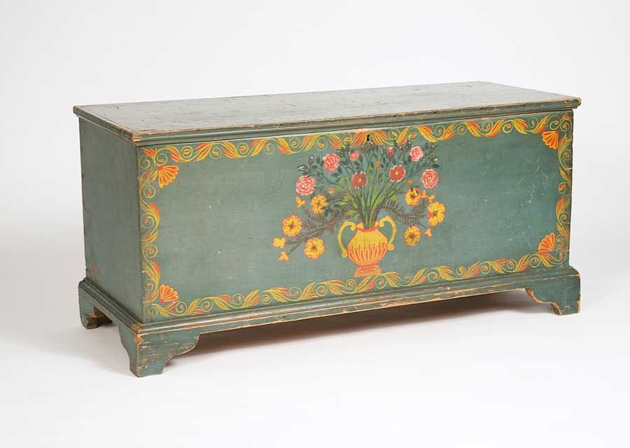 Schoharie County, New York, 1820-1825. Pine with original paint and decorations. This remarkable blue painted and polychrome freehand-decorated chest sports an elaborate vase of flowers, dominated by the cabbage rose, bordered by scroll decoration with fan corners