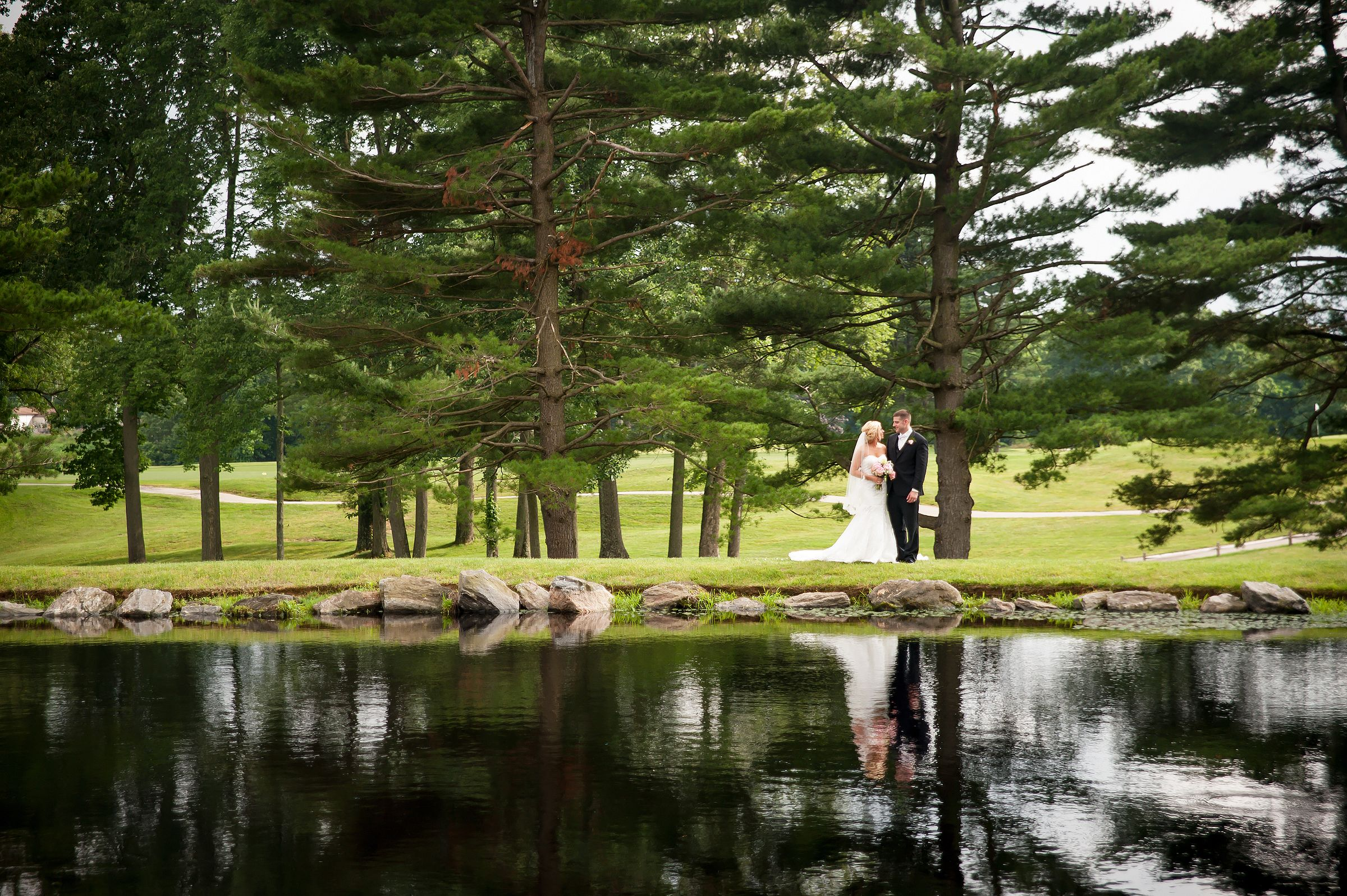 Water reflection of Bride and Groom at Springfield Country Club by Krista Patton Photography