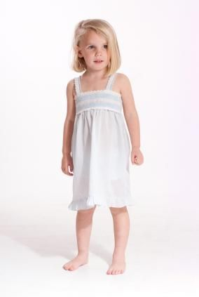 little girl in white slip