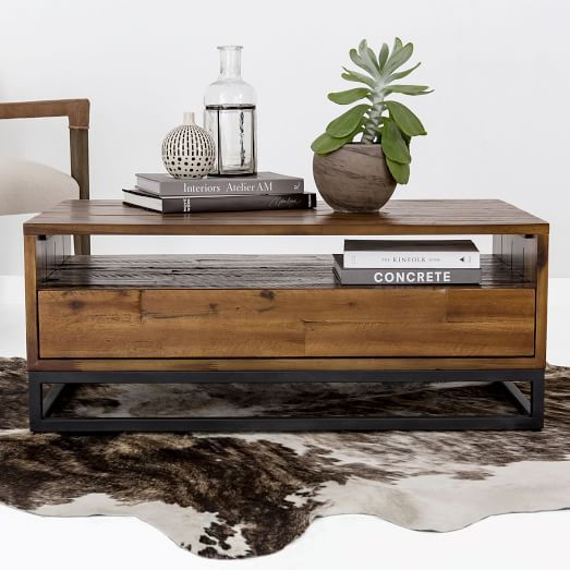 Logan Industrial Storage Coffee Table  Natural is part of Industrial Living Room Storage - Made of solid wood, resawing and roughhewing give our Logan Coffee Table its rugged good looks  The process makes each piece subtly oneofakind  It's equipped with an open shelf and a roomy drawer, giving you plenty of space for both display and storage