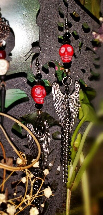 Black/Grey crystal cut bead, Red howlite skull, black and silver chain with wing embellishment earrings