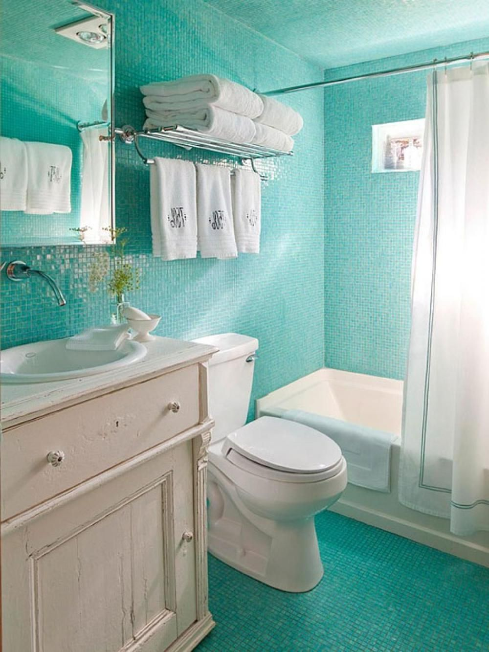 Chic turquoise mosaic tiles ocean inspired bathroom with white vintage bathroom vanity and built Small yacht bathroom design