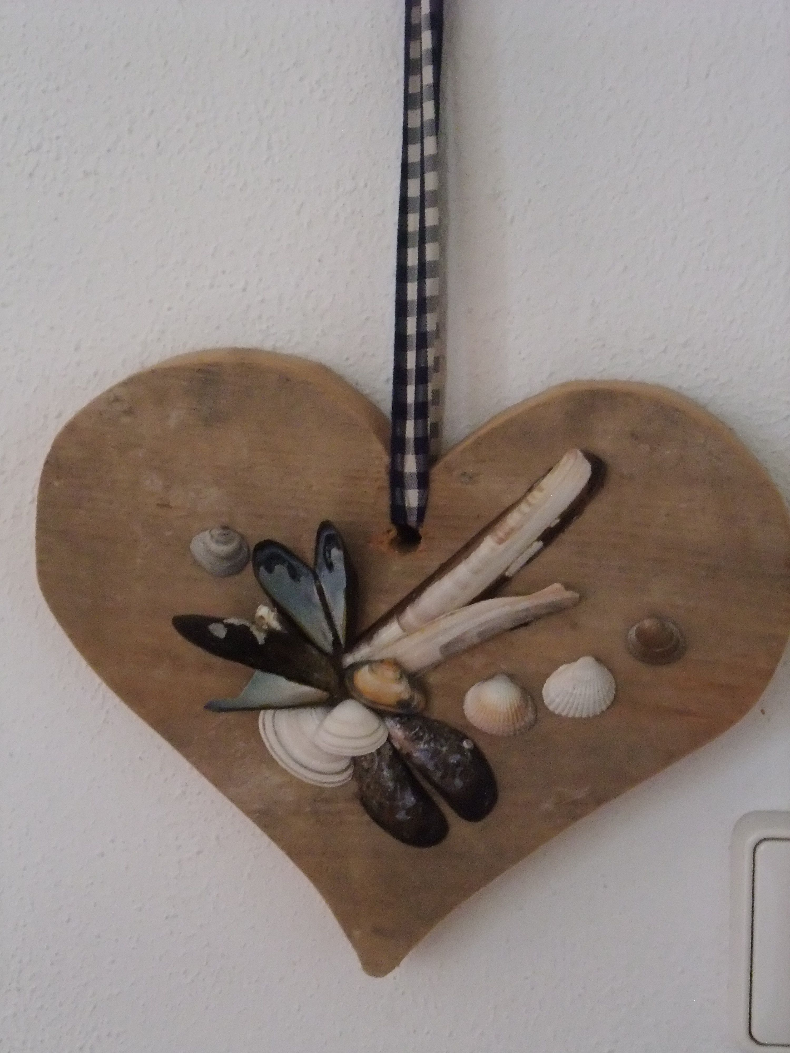Wooden heart with shells