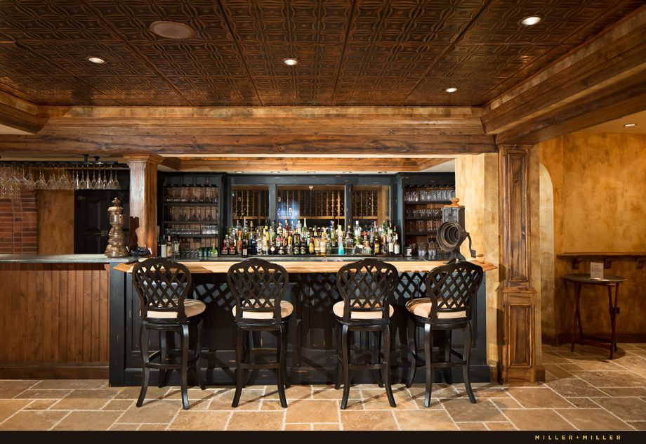 Basement bar with glass window views into the adjacent Homes with finished basements for sale