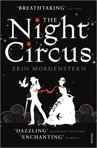 The circus arrives without warning. No announcements precede it. It is simply there, when yesterday it was not. The black sign, painted in white letters that hangs upon the gates, reads: Opens at Nigh