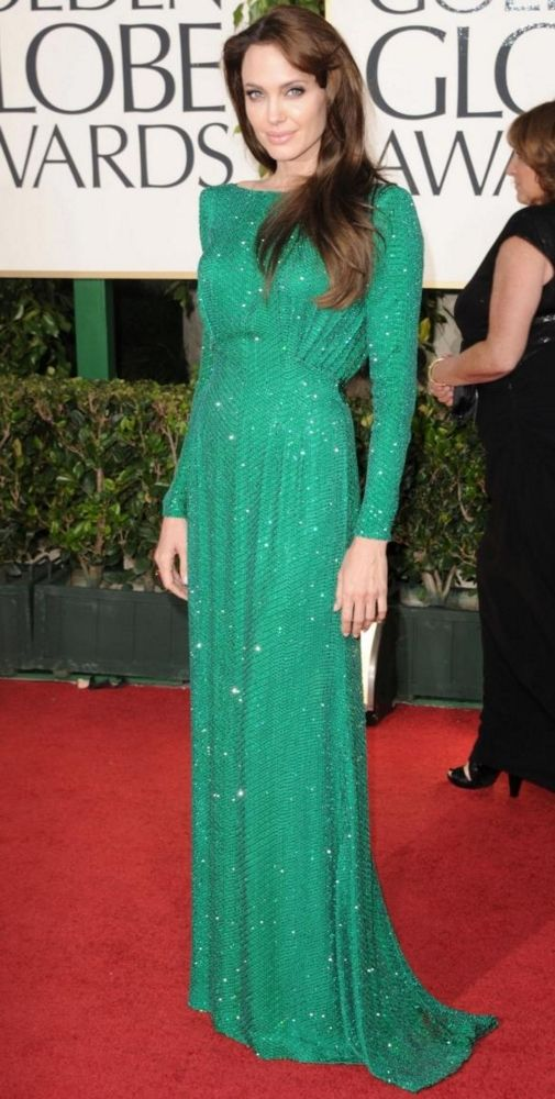 Angelina Jolie attends the 2011 Golden Globe Awards at The Beverly Hilton Hotel in Beverly Hills, California on January 16, 2011. She wore a long sleeved emerald green gown encrusted with Swarovski crystals.