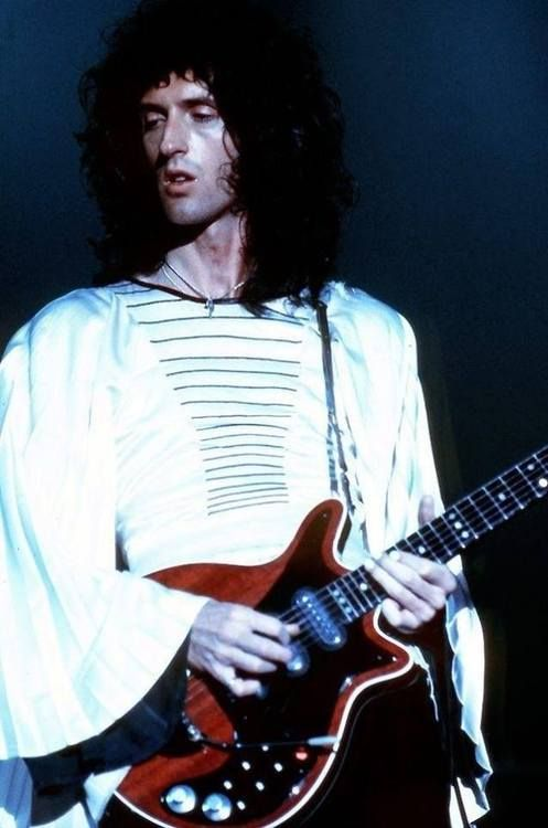If ever, in the embodiment of a man, God held a guitar he would look like this photograph of Brian May.