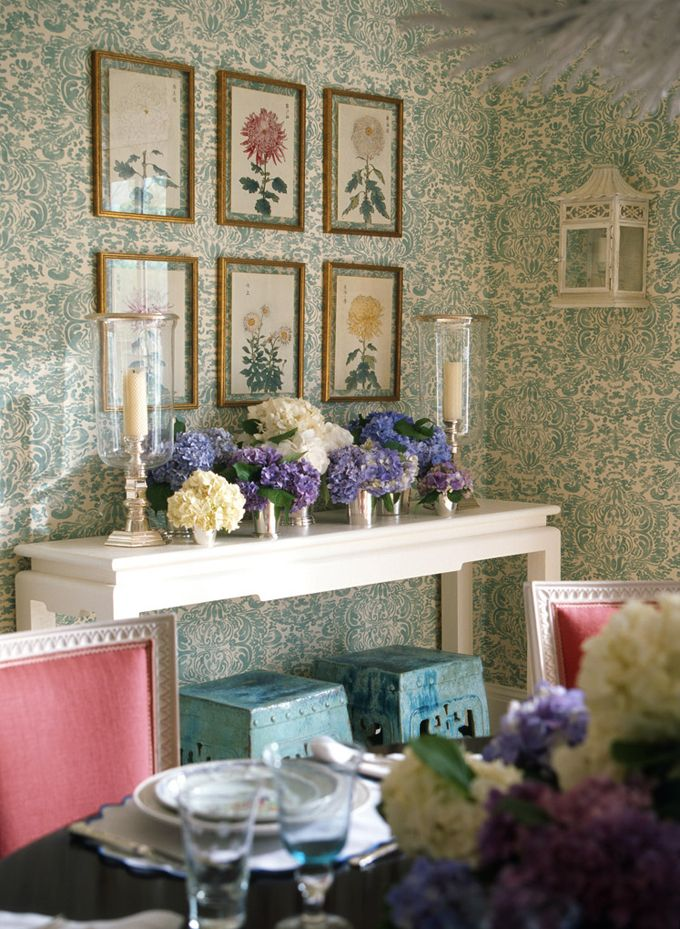 i like how the patterned wallpaper shows through the mat-less frames ...