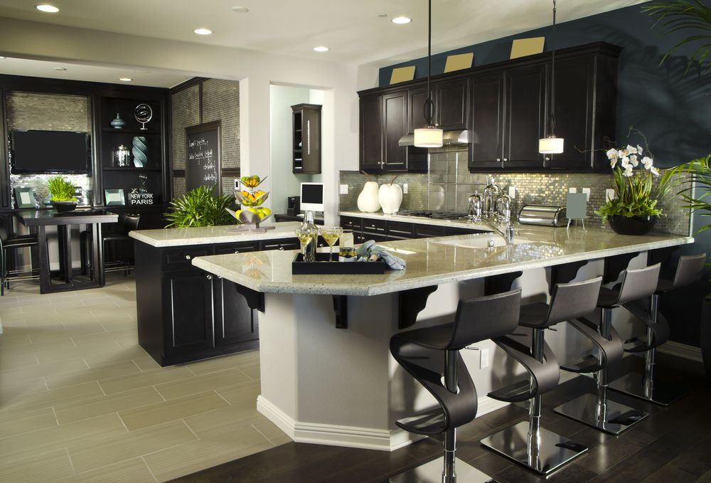 U-shaped luxury kitchen in dark and light grey. Modern kitchen design. Contemporary counter stools.