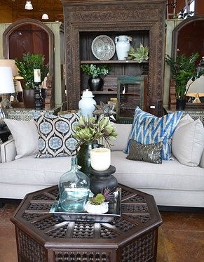 Tierra Del Lagarto - Carved bookshelf from India, moucharabi coffee table from Morocco, silk velvet ikat pillows from Uzbekistan