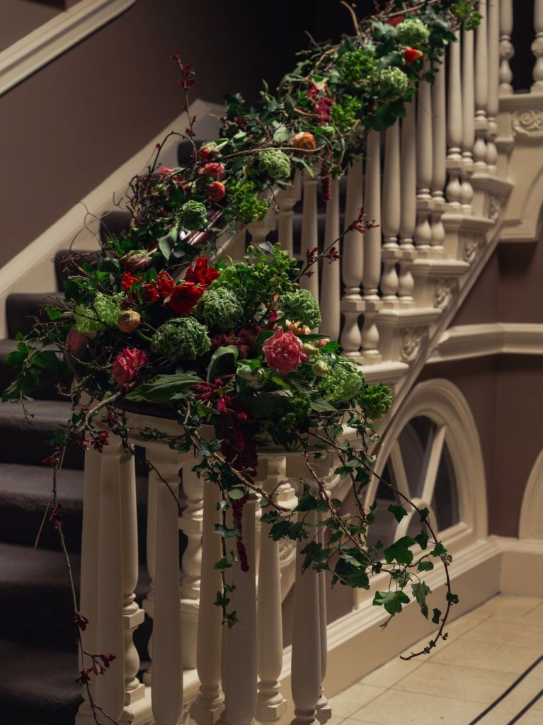 Stairs decorated with flowers for wedding