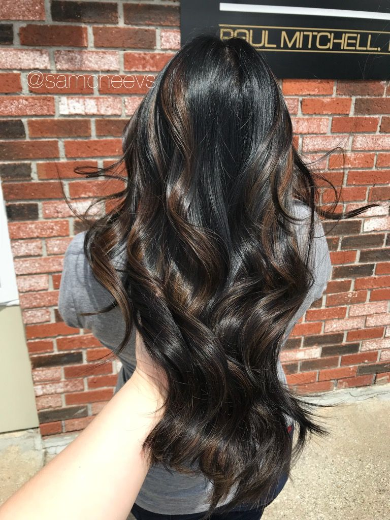 Warm natural brown highlights for jet black hair types