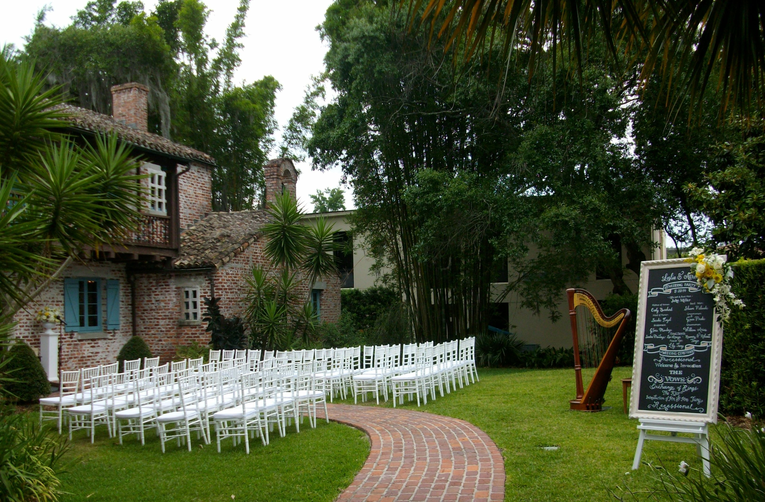 pretty outdoor wedding ceremony set up with program on chalkboard