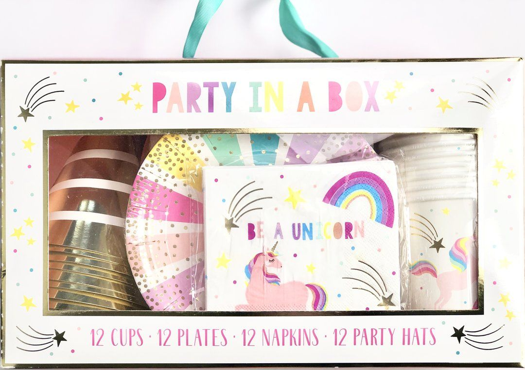 Unicorn Party in a Box - Unicorn party, Party in a box, Unicorn party plates, Unicorn theme party, Fun party supplies, Party decor shop - Colorful unicorn party box This magical party box has everything you need for a convenient unicorn themed party complete with birthday hats and all! Each kit includes 12 cups, 12 plates, 12 napkins, 12 party hats Gold Hats with ribbon Rainbow Plates Be a Unicorn cups & napkins