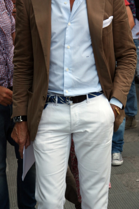 cool blue shirt  white pants colorful fabric belt  dark