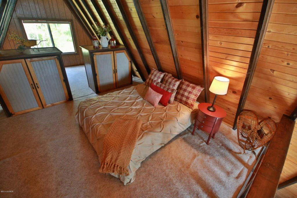 Upstairs loft with Queen and 2 twin beds on far side of