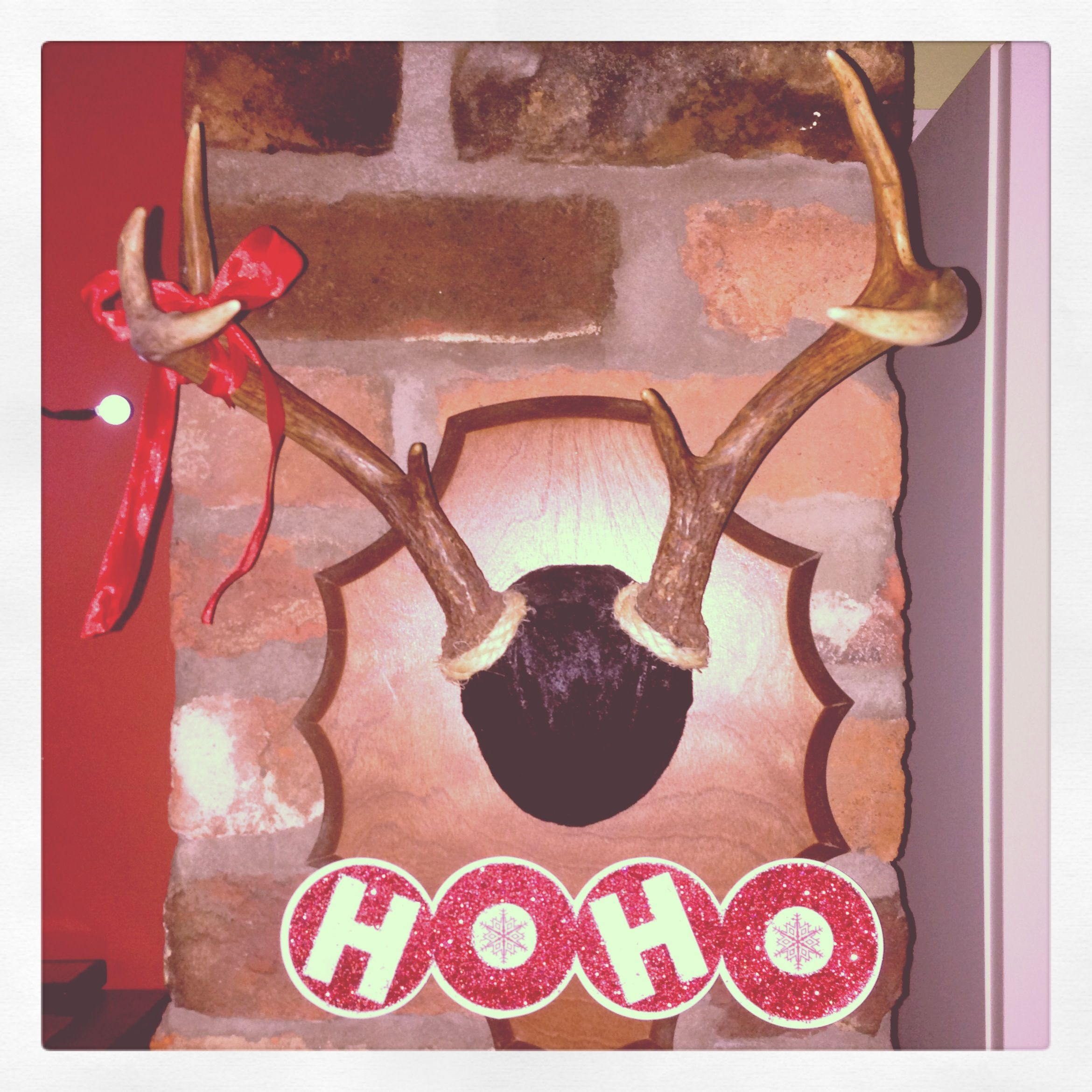 Christmas reindeer decor. Placed a red ribbon on my Rudolph. Cut a dollar store Christmas bag for the Ho Ho Ho sign. #jes