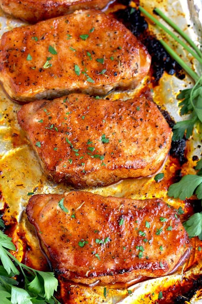 These Oven Baked Pork Chops are seasoned with simple spices and then baked to perfection. This baked pork chop recipe produces succulent, tender, juicy and flavorful pork chops every time! #PorkChops #BakedPorkChops #Dinner #ovenbakedporkchops
