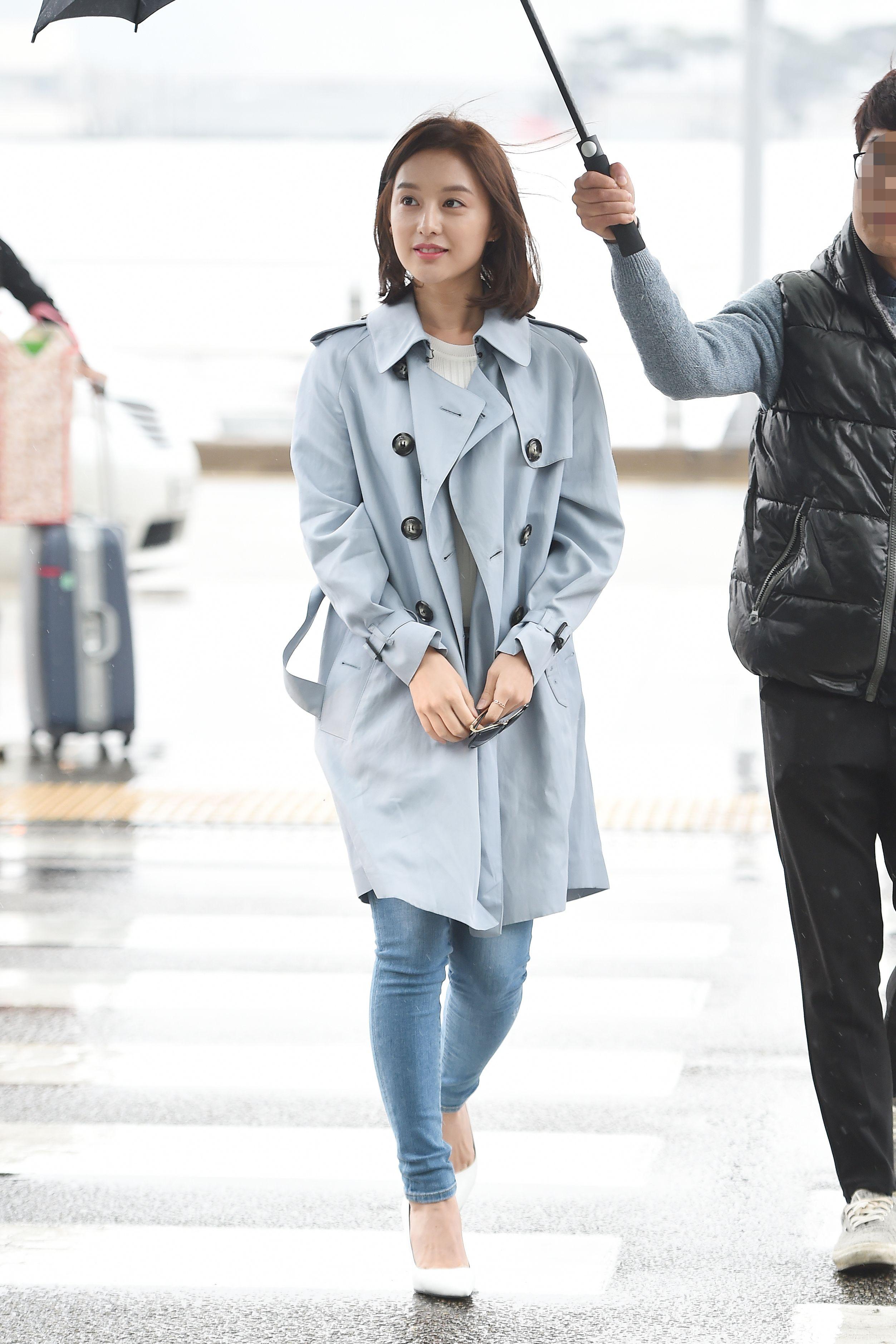 Korean Kim Ji Won actress wearing a Burberry trench coat at Incheon  International Airport in Seoul