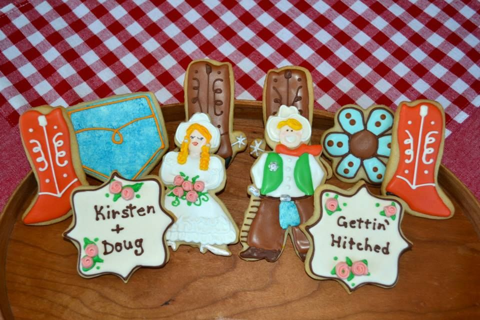 Western wedding  cookies on Facebook by Aunty Cookie's Sweet Treats with bride, groom, boots, flower, jeans pocket