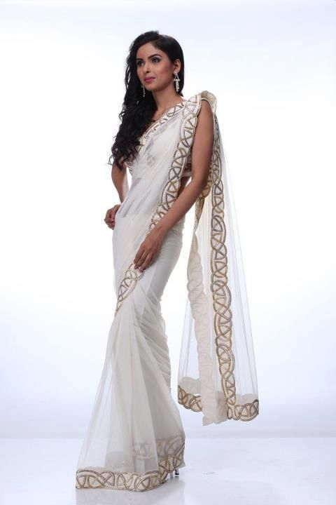 A stunning creme net saree embossed with gold and silver border adds  elegance to this ensemble. Comment below to get a custom made for you. 99ee3cfb30