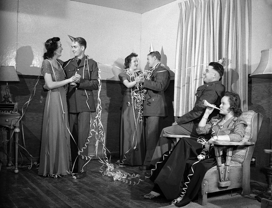 Three U.S. Army soldiers celebrating New Year's Eve with