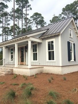 Metal roof and white farmhouse 7 652 batten and board for Tin roof house designs