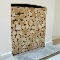 Got an empty fireplace? Make it look fabulous by filling it with decorative logs. Natural logs for display purposes (so no mould or insects!) are available from www.thelogbasket.co.uk