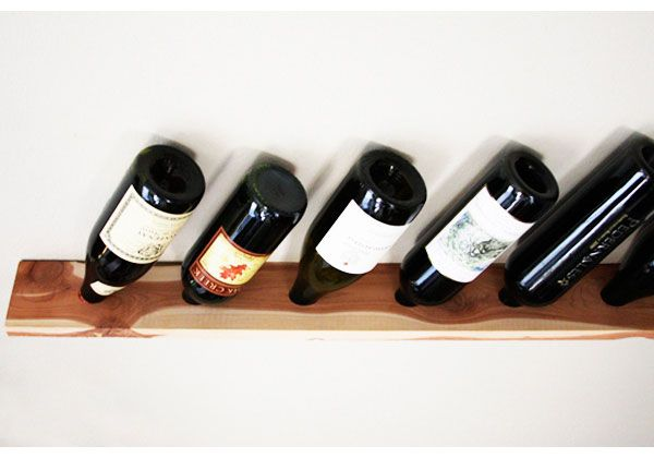 Simple Diy Wall Mount Wine Rack Of A Wood Plank Shelterness