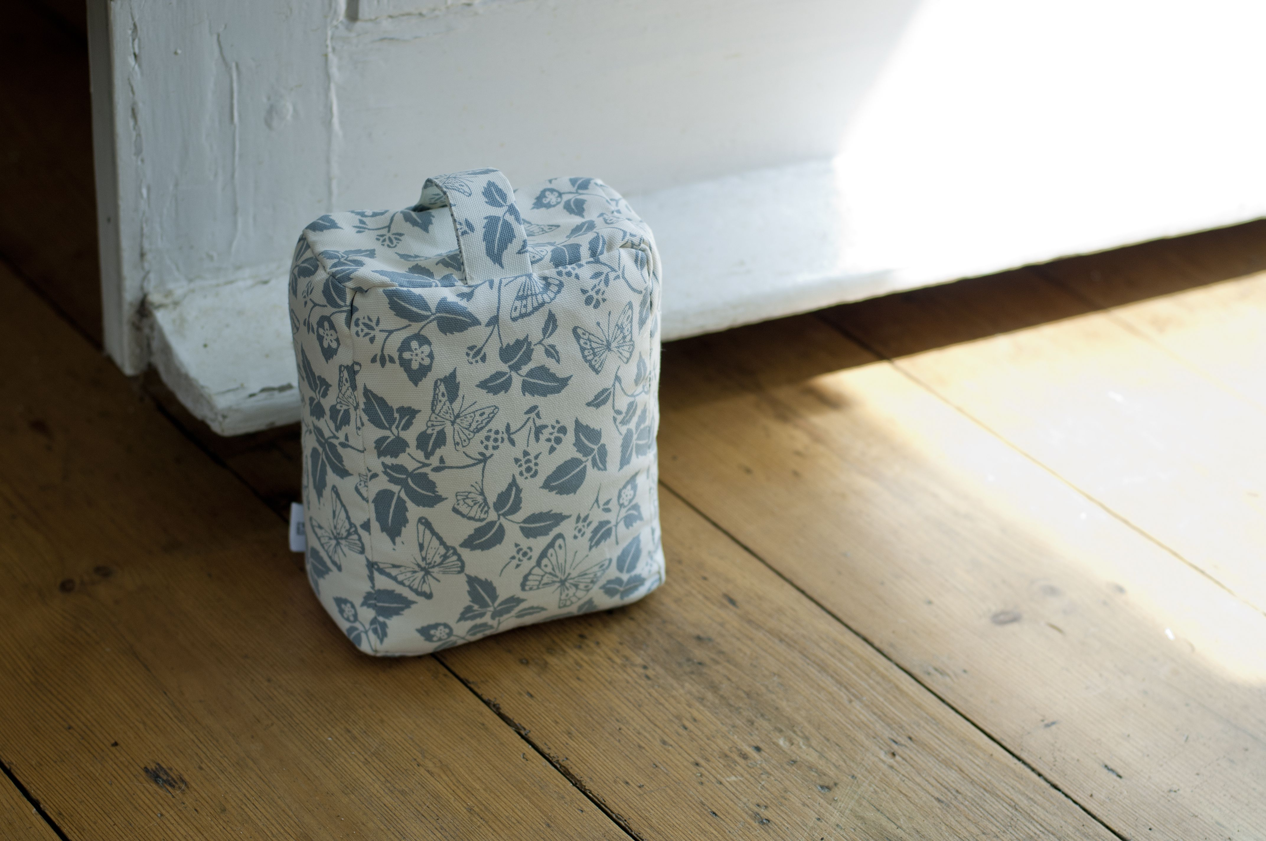 This cute #doorstop is just charming in #DuckEgg Blue Octavia fabric featuring sweet little #butterflies and #leaves